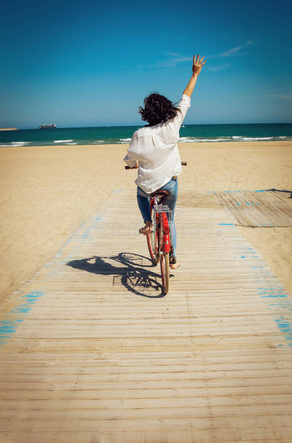 Download Young Woman Riding Bike On A Beach Stock Photo - Image: 83723613