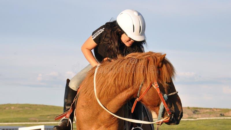 YOUNG WOMAN RIDING HORSE stock photos