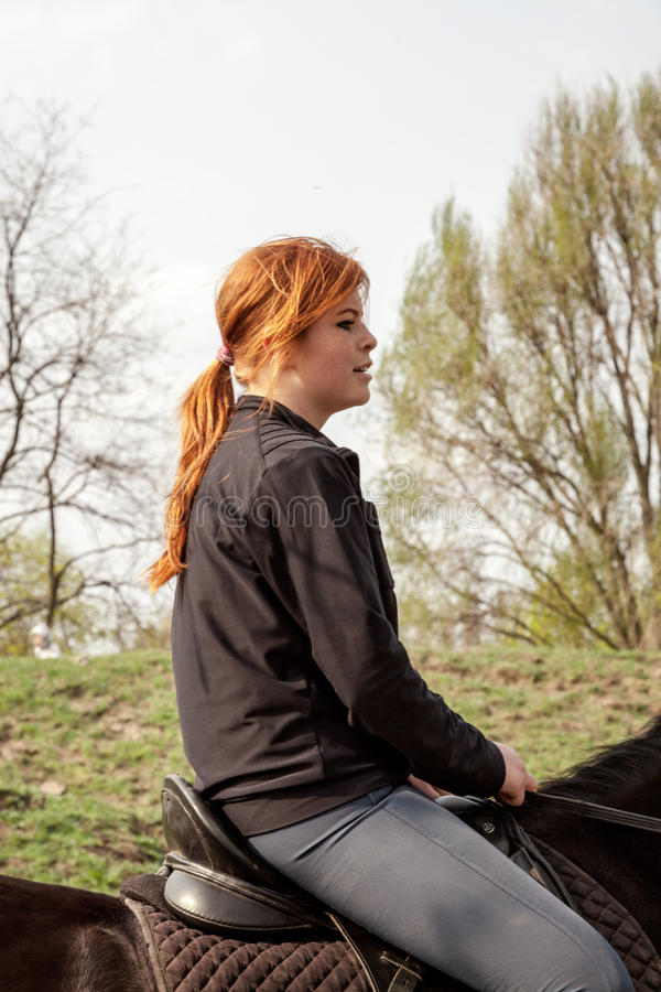Young Woman Riding Horse stock image
