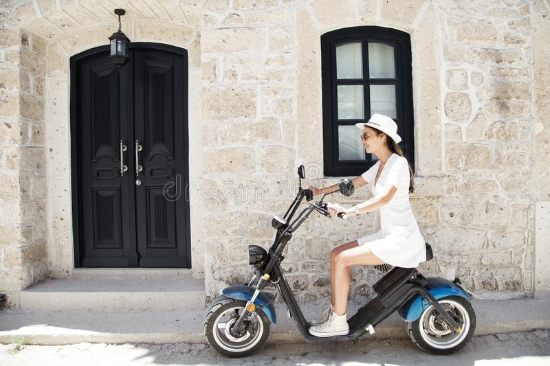 Young woman riding a motorbike . Young rider enjoying on trip. Adventure and vacations concept. Young woman riding a motorbike . Young rider enjoying on trip royalty free stock image