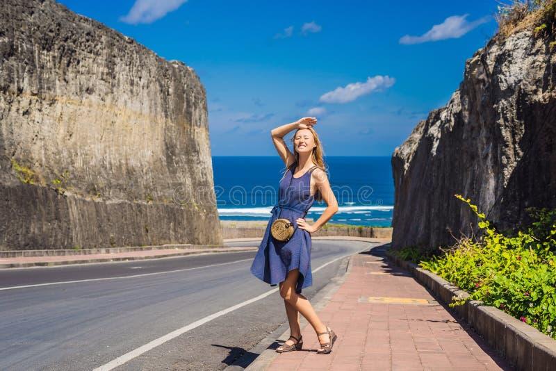 Young woman on Road to the beach Pandawa, Nusa Dua, Bali, Indonesia.  stock photography
