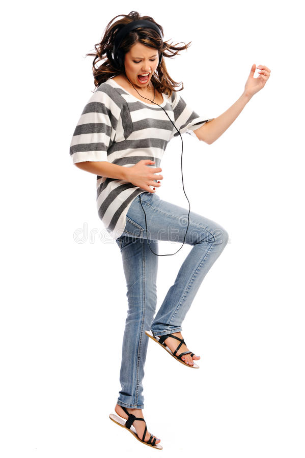 Young woman rocking to music stock image