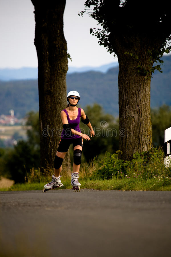 Download Young Woman On Rollerblades Stock Image - Image of helmet, exercise: 10459739
