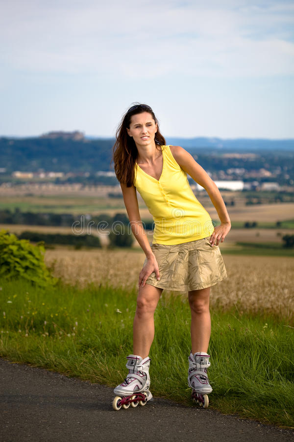 Download Young Woman On Rollerblades In The Country Stock Photo - Image: 10459720