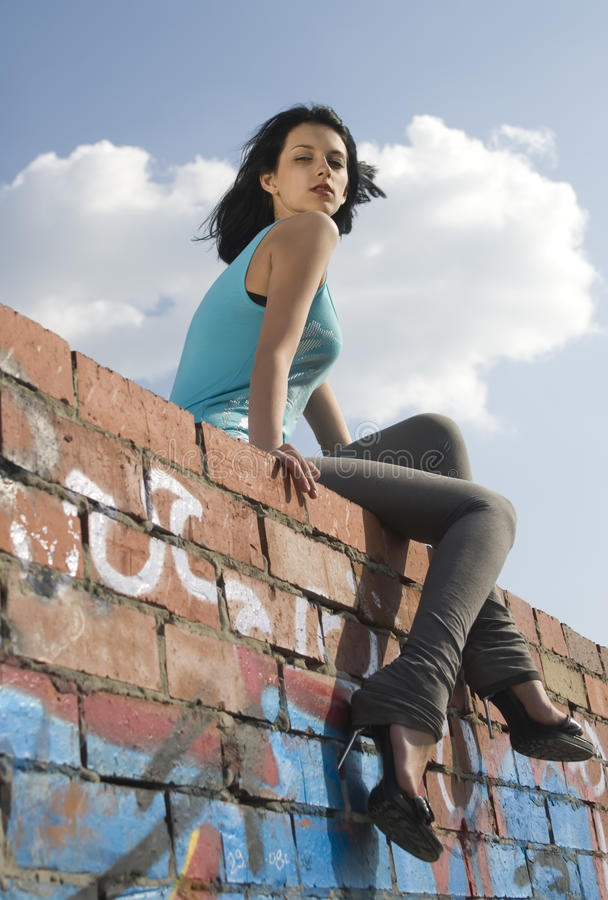 Young woman on roof royalty free stock photography