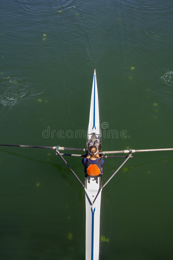 Young woman rowing in boat. On the lake stock image