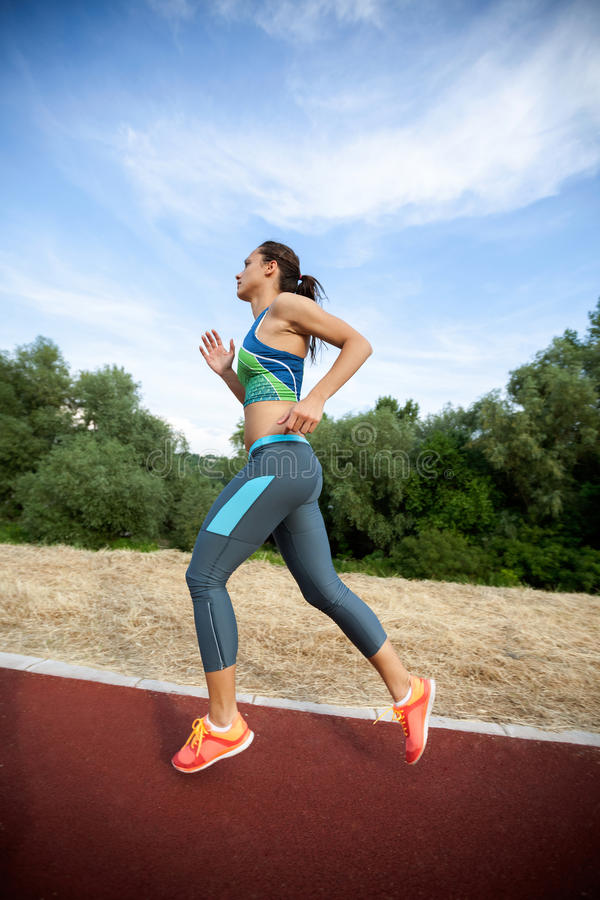 Young woman run marathon and recreating fitness sport royalty free stock photos