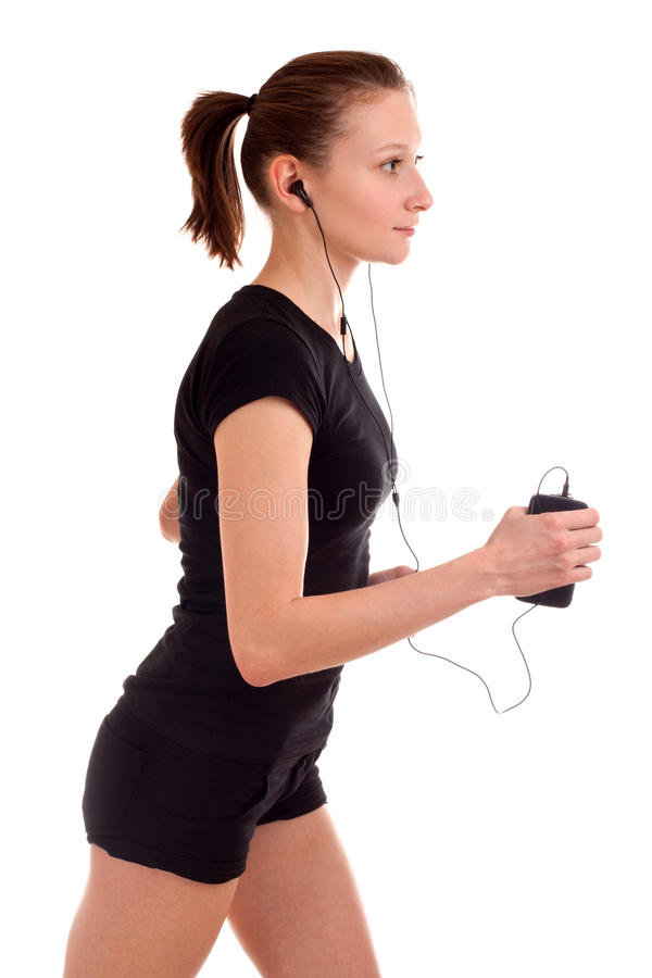 Download Young woman running stock photo. Image of listen, device - 28000104