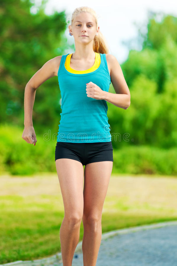 Download Young Woman Running In Green Park Stock Image - Image of recreation, motion: 23123113