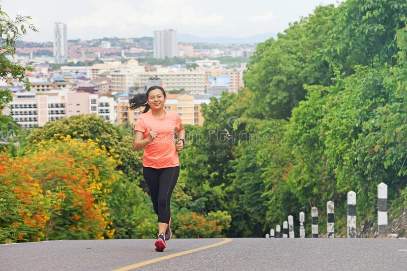 Young woman running outdoors in park stock photos