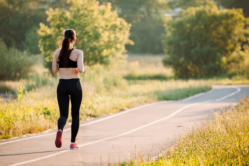 Young woman running in park stock photography