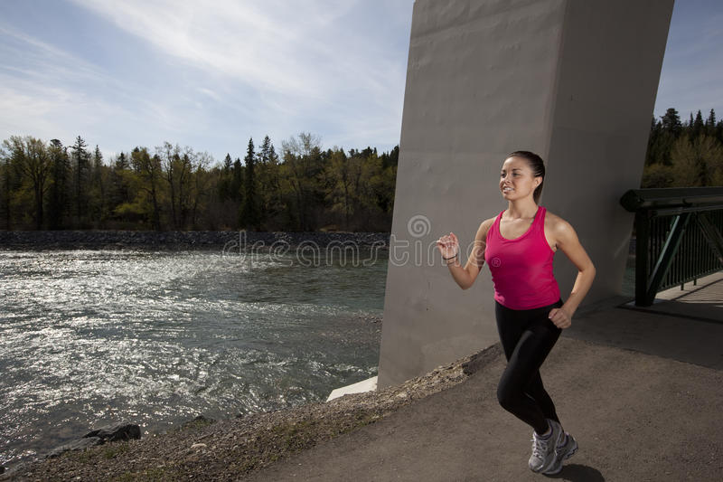 Download Young Woman Running Beside River Stock Image - Image: 14403449