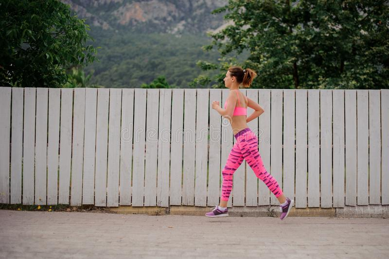 Young woman running to the new life in the morning stock photography