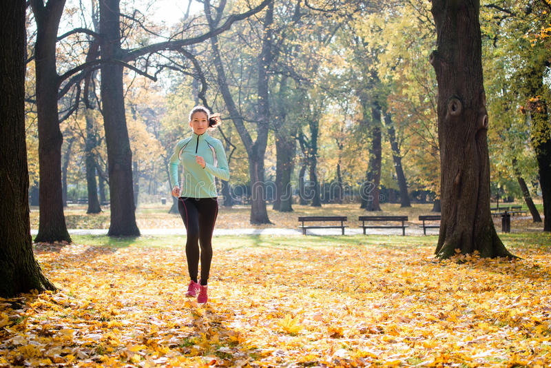 Woman jogging in nature royalty free stock photos