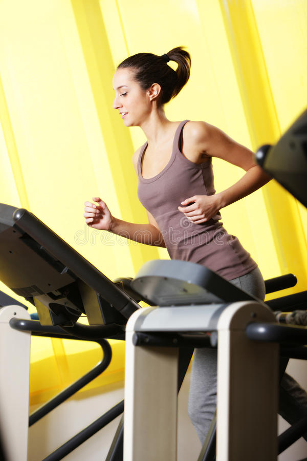 Download Young Woman Running On Treadmill Stock Photo - Image: 24154418