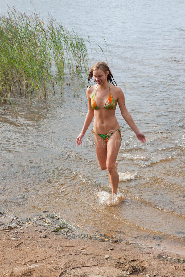 Download Young Woman Runs Out River Stock Photo - Image: 21885040