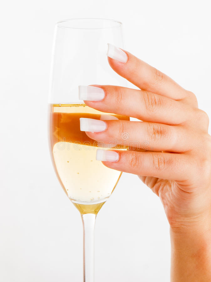 Young woman's hand with wine glass royalty free stock images