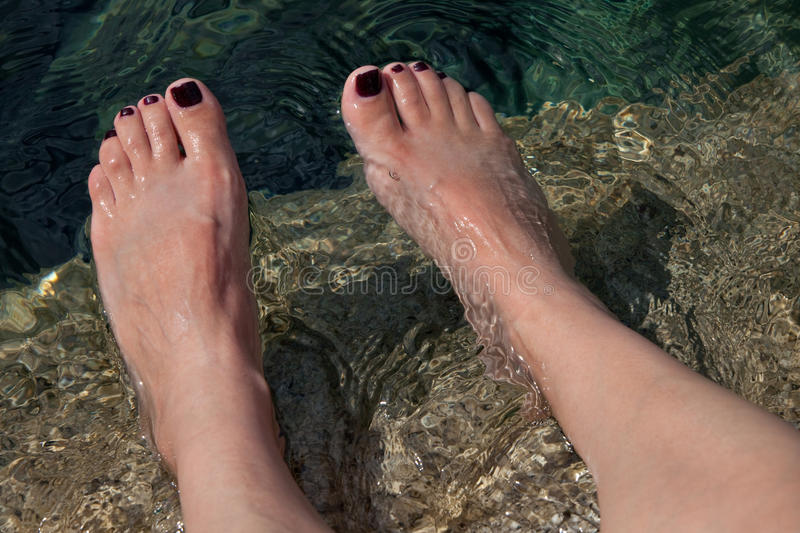 Download Young Woman's Manicured Feet In Water Stock Photo - Image: 21548086