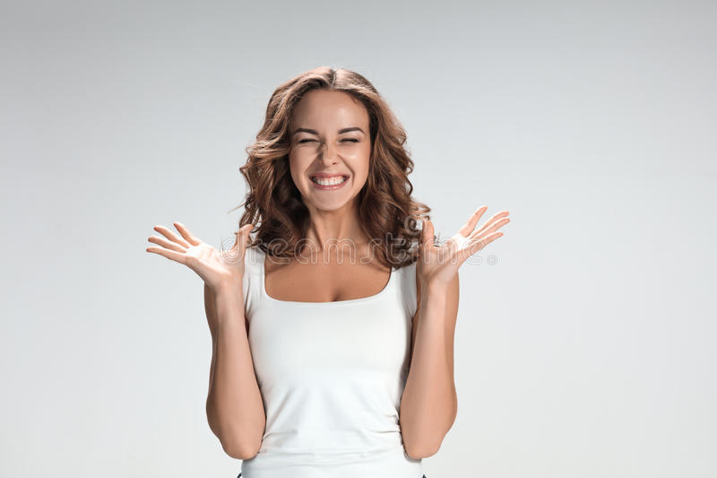 The young woman's portrait with happy emotions stock photography