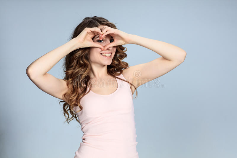 The young woman's portrait with happy emotions. On gray background stock photo
