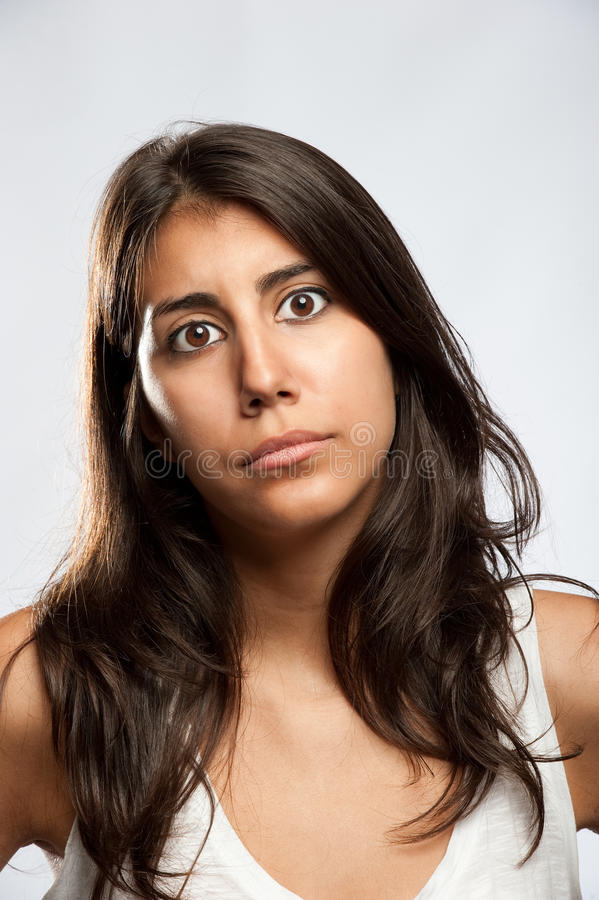 Young woman with sad expression stock photo