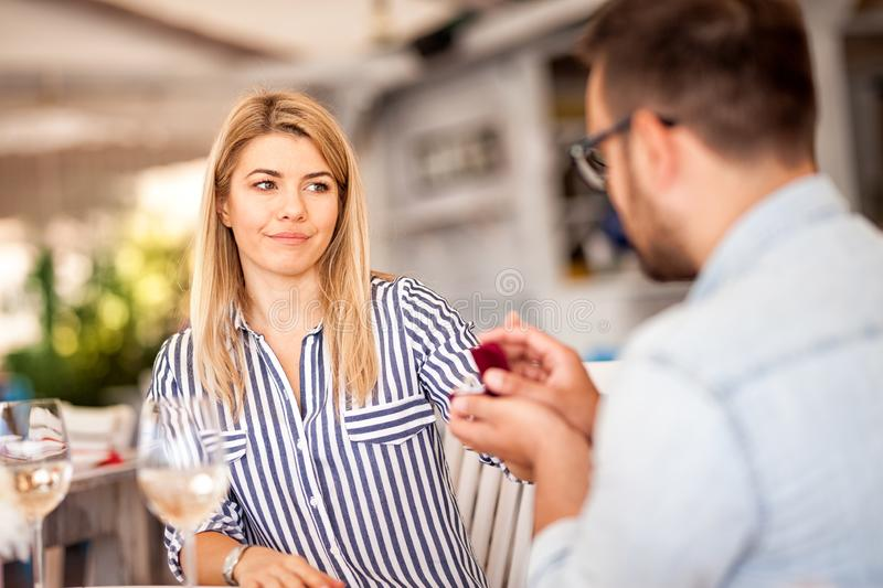 Young woman said no to proposal in cafe stock images