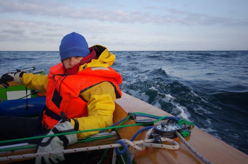 Young Woman Sailing royalty free stock photos