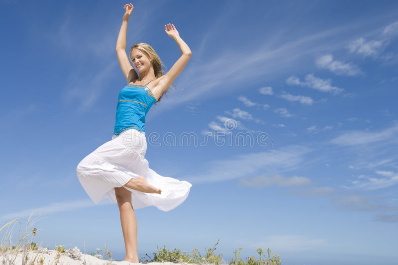 Young Woman on sand dune royalty free stock photo
