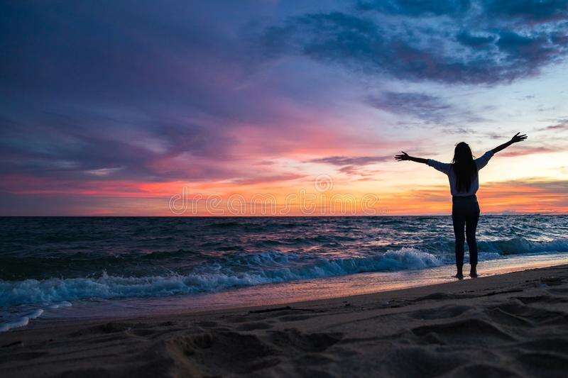 Young woman on a sandy beach. Happy Woman Enjoying Beautiful Sunset on the Beach stock photos