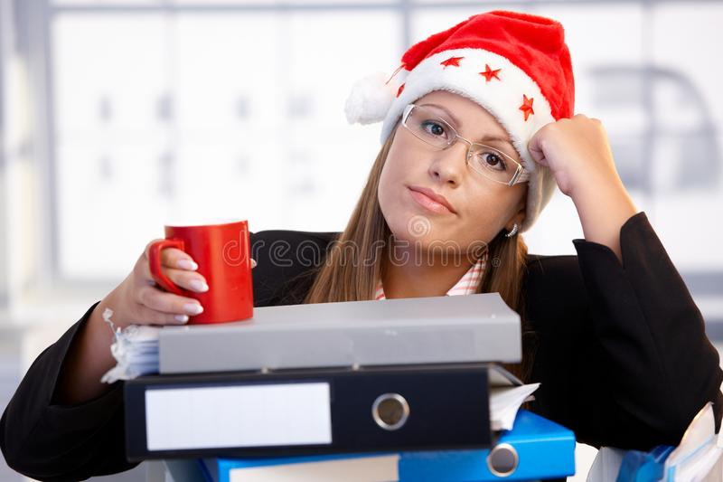 Download Young Woman In Santa Hat Exhausted In Office Stock Photo - Image: 17164898