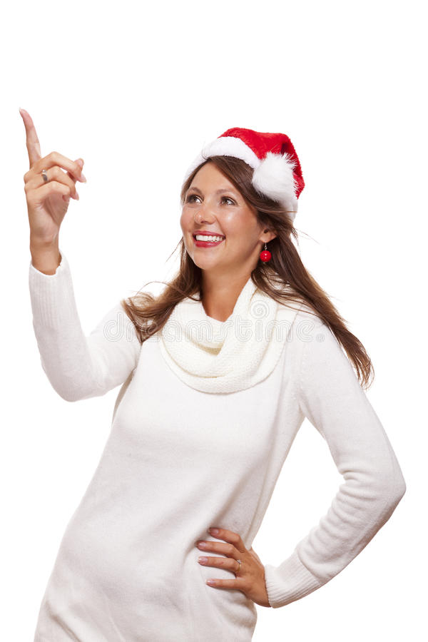 Young woman in a Santa hat holding out her hands. With her empty palms upwards for placement of your Christmas and seasonal products, isolated on white with stock images
