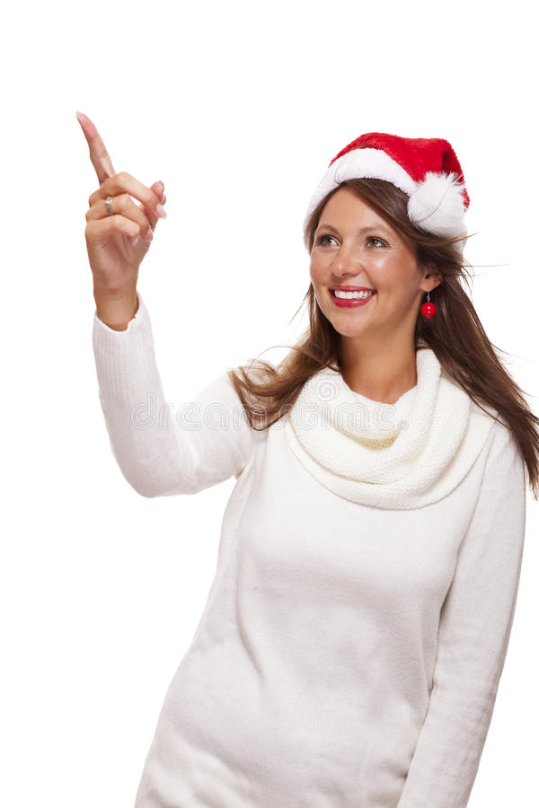 Young woman in a Santa hat holding out her hands. With her empty palms upwards for placement of your Christmas and seasonal products, isolated on white with royalty free stock images