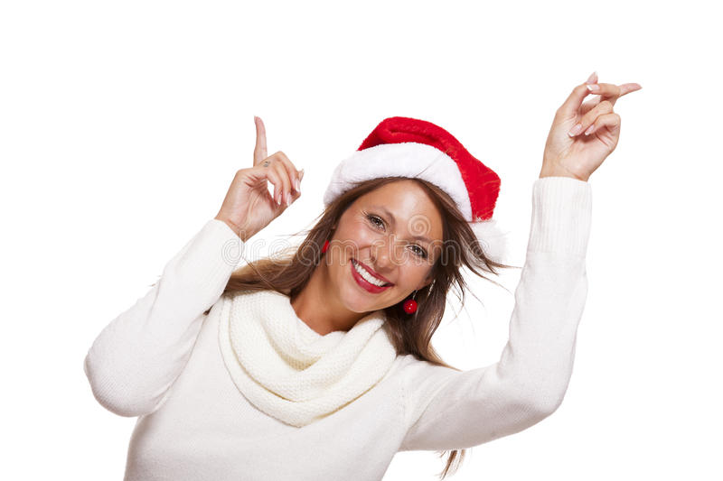 Young woman in a Santa hat holding out her hands. With her empty palms upwards for placement of your Christmas and seasonal products, isolated on white with royalty free stock photos