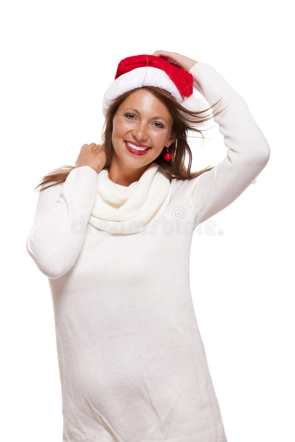 Young woman in a Santa hat holding out her hands. With her empty palms upwards for placement of your Christmas and seasonal products, isolated on white with royalty free stock image