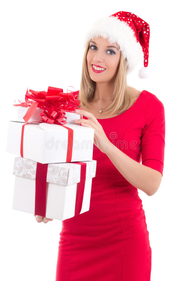 Young woman in santa hat posing with gift boxes isolated on whit stock images