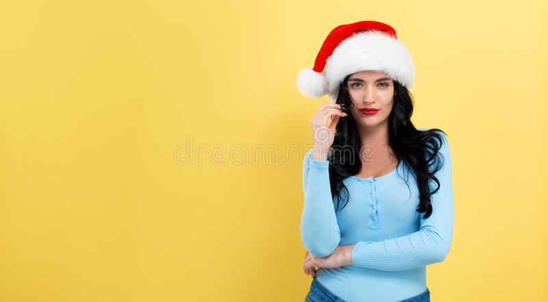 Young woman with a Santa hat stock images