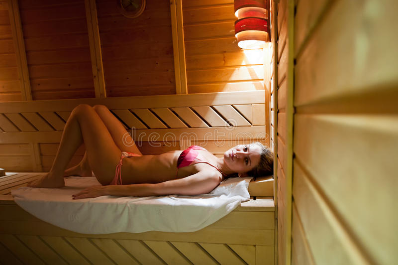 Young Woman in sauna royalty free stock photography