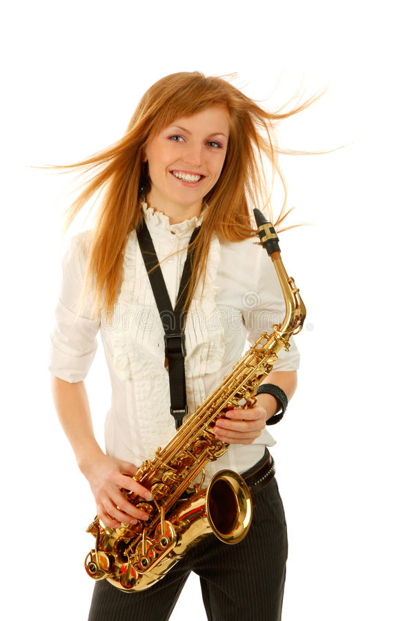 Young woman with saxophone. Isolated background stock images
