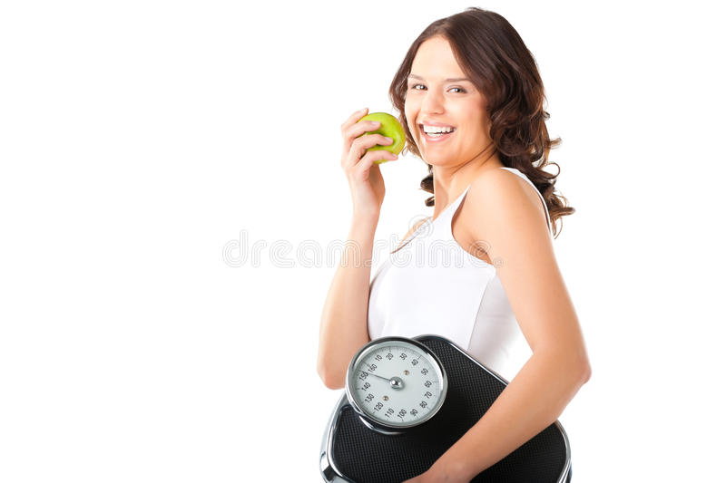 Young woman with scale under her arm and apple