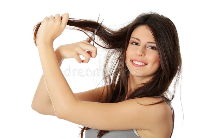Download Young woman with scissors stock image. Image of brunette - 23535929