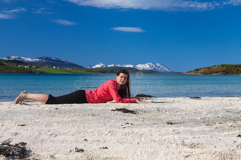 Young woman on sea beach stock image