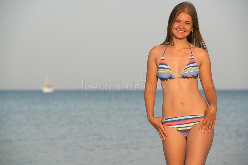 Young woman on the sea royalty free stock photography