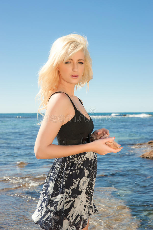 Download Young Woman With A Sea Shell Stock Image - Image of vacation, leisure: 15920761