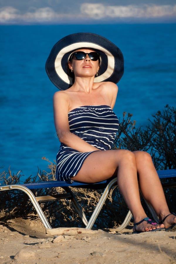 Young woman at sea shore stock photo