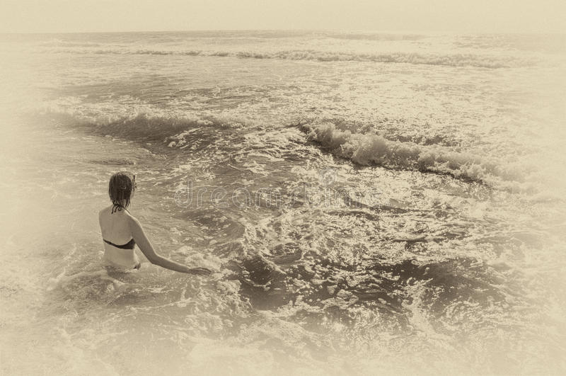 Young woman in the sea stock photo