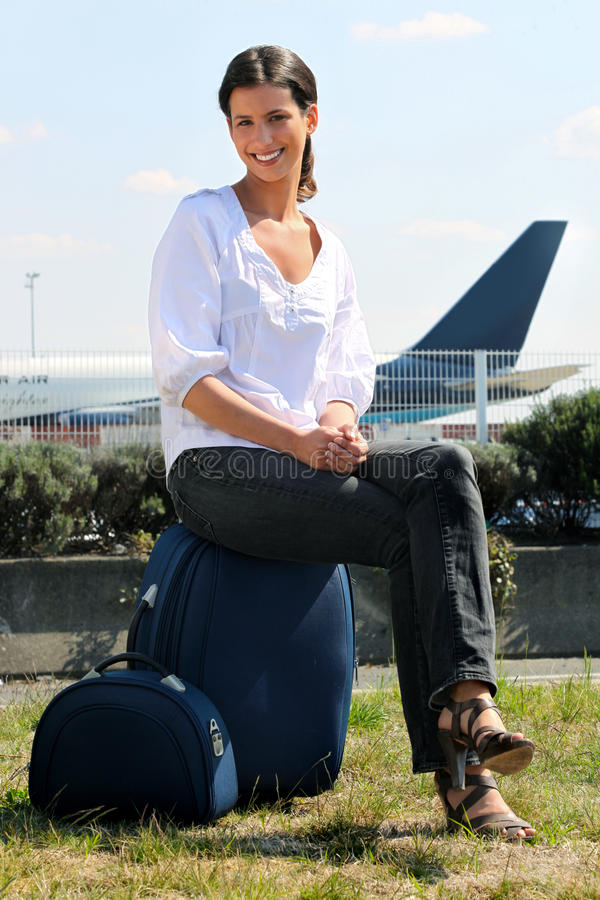 Download Young Woman Seated On Luggage Stock Image - Image: 21257467