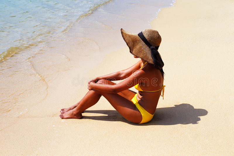 Download Young Woman Seating Down On A Sandy Beach And Sun Bathing Royalty Free Stock Photo - Image: 31007775