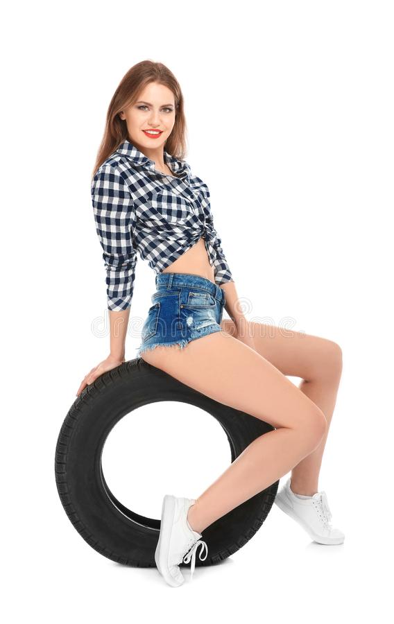 Young woman in seductive outfit with car tire stock photos