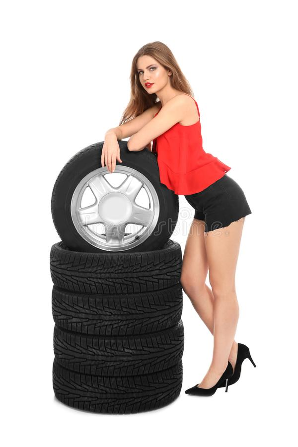Young woman in seductive outfit with car tires stock photos