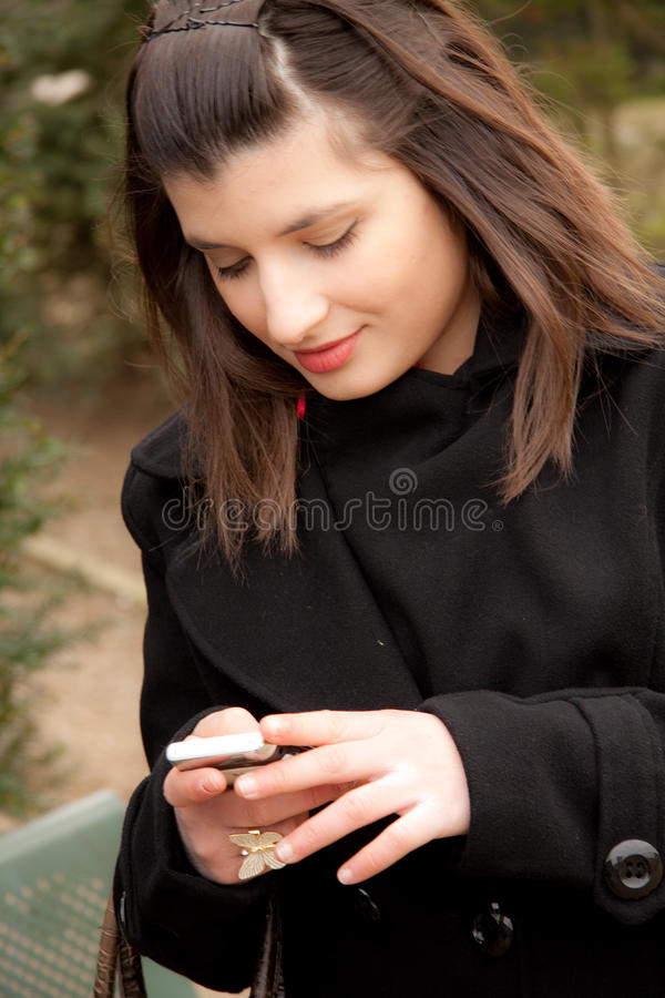 Download Young Woman Is Sending A Sms Stock Photo - Image: 18429934